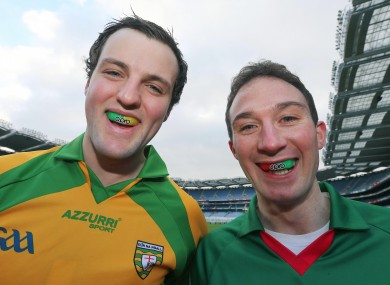 Donegal's Michael Murphy and Alan Dillon of Mayo.