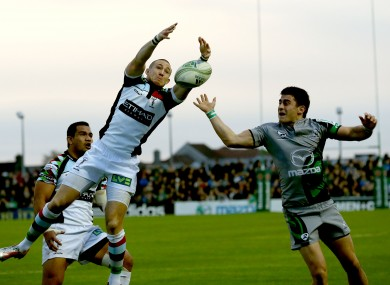 Mike Brown of Herlequins and Tiernan O'Halloran compete for a bouncing ball.