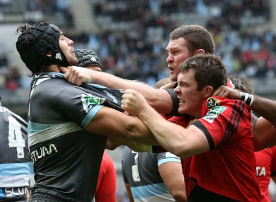 Munster's Donnacha Ryan and Peter O'Mahoney get involved with Racing Metro's Antoine Battut.