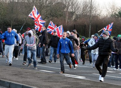 Loyalists react during clashes with nationalists at the Short Strand area of Belfast earlier this month