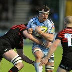 Cardiff Blues' Robin Copeland runs into Saracens' Eoin Shefiff (left) and James Short.
