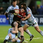 Saracens' Duncan Taylor is tackled by Cardiff Blues' Gavin Evans (bottom left).