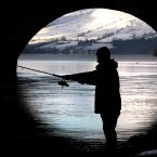 A fisherman casts his line into the river Tay at Kenmore as the salmon fishing season was declared open. (PA)