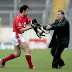 Cork defender Sean Óg Ó hAilpin then intervenes to ensure the game can proceed to the final whistle in Thurles.