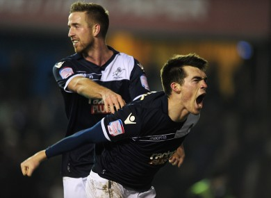 Millwall's John Marquis (front) celebrates after scoring his team's second goal.