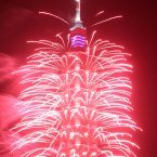 A firework display explodes off Taiwan's tallest skyscraper Taipei101. (AP Photo/Chiang Ying-ying)