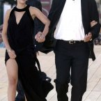 Bill Murray holding hands with Scarlett Johansson.