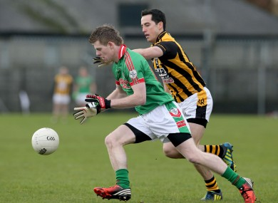 Crossmaglen's Aaron Kernan and Darren Dolan of St Brigid's