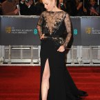 Amy Adams in, er, black at the BAFTAs. Nice J-Lo leg though.