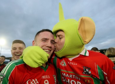 Ballymun's Davey Byrne celebrates with fan Darragh Joyce.