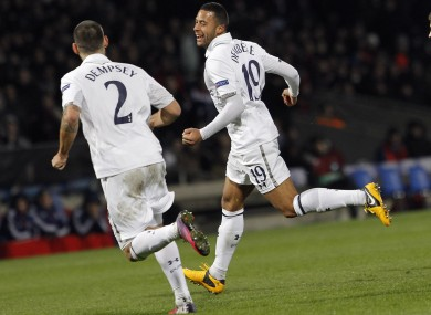 Mousa Dembele, center, celebrates with Clint Dempsey.