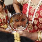 A dancer from the southern Indian state of Karnataka prepares to perform for a press preview ahead of the Surajkund Fair on the outskirts of New Delhi, India, Thursday, Jan. 31, 2013. The fair is held for two weeks and features culture and crafts from all of India's states, its South Asian neighbors and other countries in the world. (AP Photo/Tsering Topgyal)