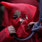 An Egyptian child wears a red hood and a noose during an anti-government protest in front of Egypt's high court building in downtown Cairo, Friday, Feb. 22, 2013. Egypt's president called multi-stage parliamentary elections beginning in April but a key opposition leader warned Friday that the vote may only inflame tensions unless there are serious political talks first.(AP Photo/Khalil Hamra)