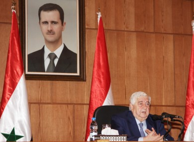 Syrian Foreign Minister Walid al-Moallem speaks at a press conference in Damascus, Syria, Monday, Dec. 19, 2011.