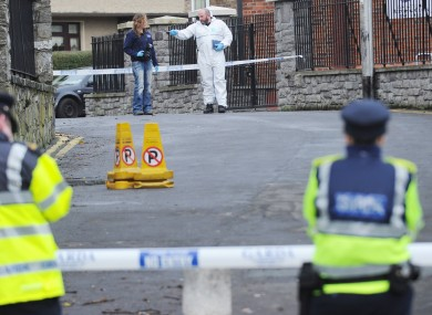 Gardaí and forensic teams investigate the shooting of Christopher Warren in the Broadstone area of Dublin