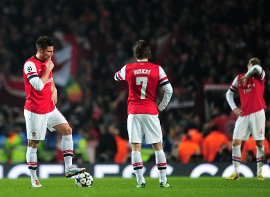 Arsenal's Tomas Rosicky (centre) and Olivier Giroud (left) stand dejeced as they wait to restart the game after conceding their third goal.