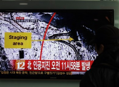 A South Korean passenger watches TV news reporting an earthquake in North Korea as a result of the nuclear test