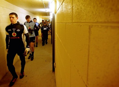 Net gain: Stephen Cluxton leads out his team.
