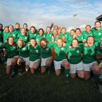The Ireland players celebrate after their historic Triple Crown success.