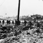 German soldiers advance through wrecked suburbs of Stalingrad in Russia on Oct. 20, 1942 during the fierce fighting now going on in the northern factory district. (AP Photo)