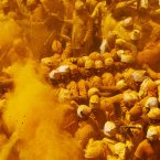 Devotees throw turmeric powder as an offering to the shepherd god Khandoba on 'Somavati Amavasya' at the Jejuri temple in Pune district, Maharashtra state, India. 'Somavati Amavasya' is the day when a New Moon falls on a Monday. (AP Photo/Rajanish Kakade)