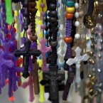 Rosary beads hang for sale outside Nazarenas church in downtown Lima, Peru. Latin Americans reacted with joy on Wednesday at news that the Argentine Cardinal Jorge Mario Bergoglio, was elected pope. Bergoglio, who chose the name Pope Francis, is the first pope ever from the Americas. (AP Photo/Martin Mejia)