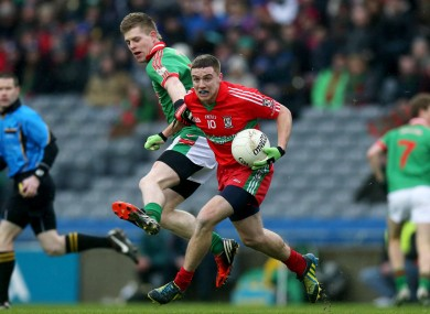 Ballymun Kickhams Davey Byrne and St Brigid's Darren Dolan in action.
