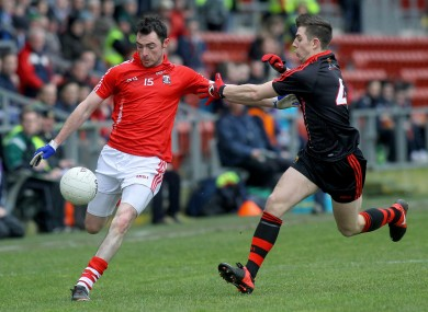 Down's Ryan Boyle with Cork's Donncha O'Connor.