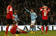 Tevez hat-trick eases Man City past Barnsley