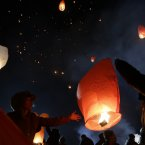 South Koreans release paper lanterns to celebrate the first full moon of the Lunar New Year, in Yongin, South Korea. (AP Photo/Lee Jin-man)